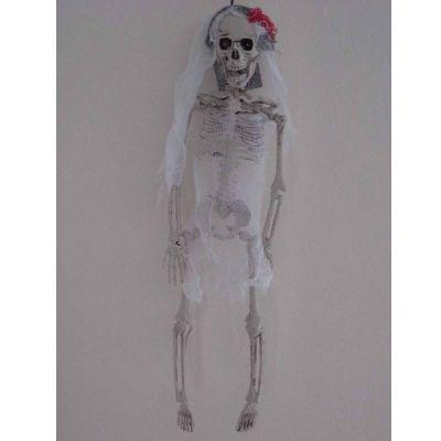 Squelette de mariée et son noeud rouge